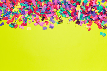 festive party decor and confetti on colored background
