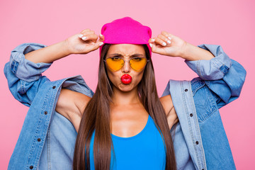 I'm offended by you! Don't talk to me! We aren't friend anymore! Close up photo portrait of sad unhappy attractive girl wearing yellow transparent glasses touching hat isolated bright background