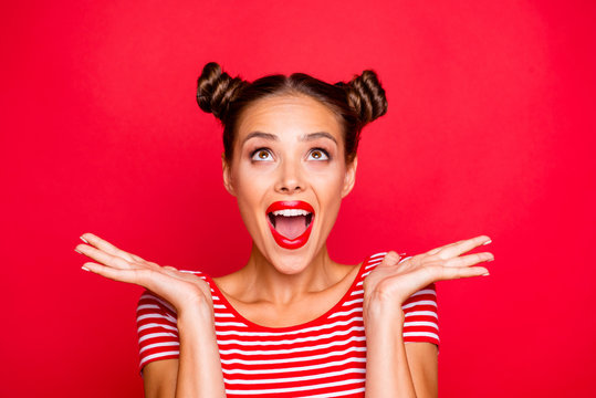 So excited and positive girl isolated on red background loud laughs raising her head and hands up. Concept of advertising, sale and discount isolated on red background