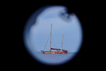 NGO Proactiva Open Arms rescue boat Astral is seen through a porthole in central Mediterranean Sea