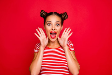 WOW! Portrait of astonished surprised girl with wide open mouth eyes gesturing with palms near face isolated on red background
