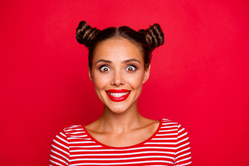 Closeup of happy face young girl with red lips and big brown eyes look at camera on red background