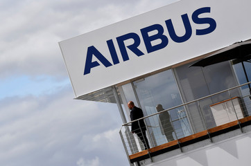 A man stands at an Airbus trade pavilion at Farnborough International Airshow in Farnborough, Britain