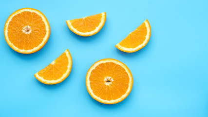 Oranges fruit on a blue background.