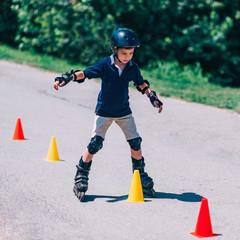 Boy on roller skating class
