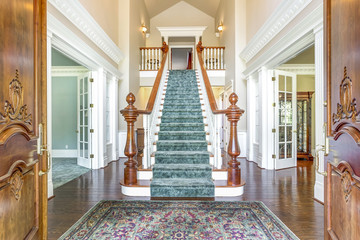 Grand two story foyer with elegant staircase. Wall mural