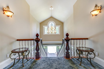 Stunning foyer with elegant staircase.