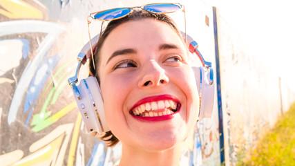 Young woman sunglasses headphones portrait summer