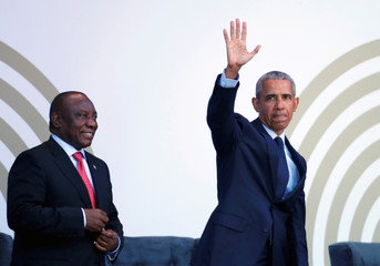 Accompanied by South African President Cyril Ramaphosa, former U.S. President Barack Obama arrives to deliver the 16th Nelson Mandela annual lecture