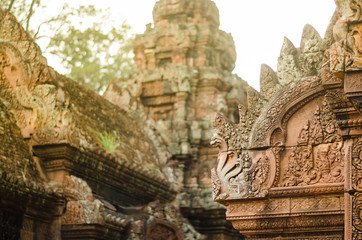 Carved stone decors on Bantai Srei buddhist temple's roofs in Angkor Wat park, Cambodia