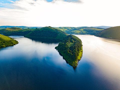 An aerial landscape of the lake near the Llyn Clywedog Dam