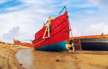 Wooden Indian fishing boats docked at Orissa coastal creek waiting for high sea tide.