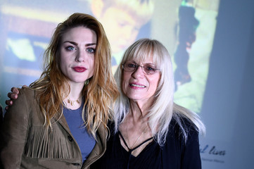 Kurt Cobain's daughter Frances Bean Cobain and his mother Wendy O'Connor pose for a photograph in front of a home movie of Kurt at the opening of 'Growing Up Kurt' exhibition featuring personal items of Nirvana frontman Kurt Cobain at the museum of Style I
