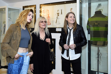 Kurt Cobain's daughter Frances Bean Cobain, his mother Wendy O'Connor and sister Kim Cobain watch a home movie of Kurt during opening of 'Growing Up Kurt' exhibition featuring personal items of Nirvana frontman Kurt Cobain at the museum of Style Icons in N