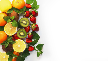 citrus fruits  and strawberries on a white background
