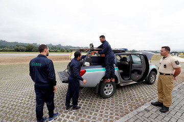 Members of GIPS, elite firefighters, prepare a car during a training session at their base near Pombal