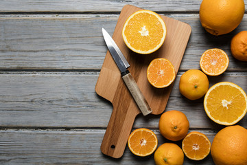 Freshly cut oranges on a rustic wooden background