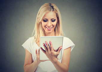 Smiling woman using modern tablet
