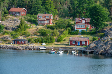 Swedish-style houses on the rocky coast of archipelago in Sweden