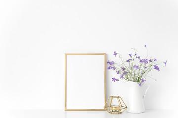 Gold portrait a4 frame mockup template with summer flowers in vase on white background. Empty frame mock up for presentation design, modern art.