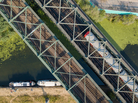 Canal and metro train bridge transportation infrastructure view from above with a drone