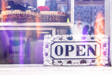 Open sign in clothing store.