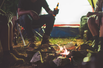 Friends are camping in the night.