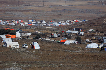 A general view shows refugee tents erected at the Syrian side of the Israeli Syrian border as it is seen from the Israeli-occupied Golan Heights