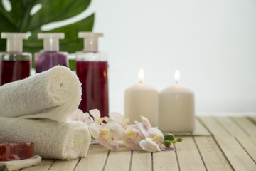 Items for spa, baths, saunas in still life: towels, soap, shampoo and rose