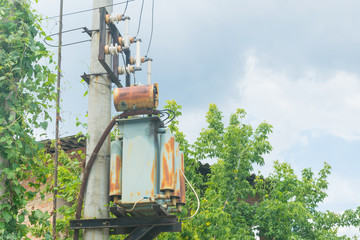 Electric transformer on the pole.