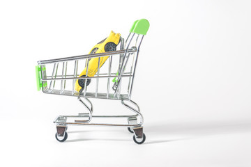 A car in a shopping basket on a white background.  Buying a car.