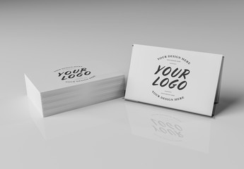 Stack of Business Cards on White Desk Mockup