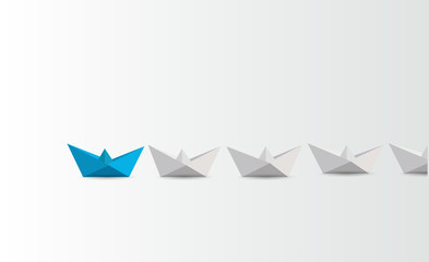 Leadership concept. blue paper boat leading white.
