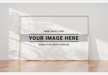 White Frame on Wooden Floor Mockup