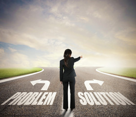 Businesswoman at a crossroads. She chooses the correct way. Concept of decision in business