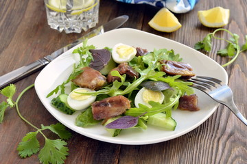Chicken and vegetable salad with quail eggs