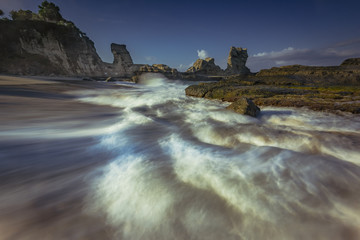 Beautiful beach in long exposure shot photography; Java, Indonesia