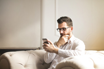Man with a smartphone in the living room