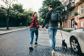 Loving couple with pet french bulldog