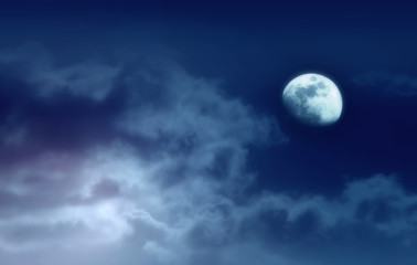 Background of night sky with mysterious clouds and moon. Moon is taken by me with my camera.