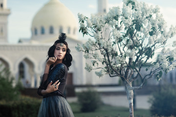 girl in grey dress on mosque background
