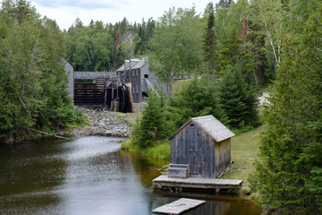 Old wooden sawmill on river