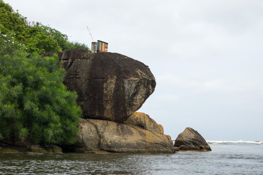Island with a Buddhist temple, the city of Bentota in southwest Sri Lanka