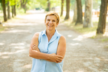Portrait of a happy mature woman in the park