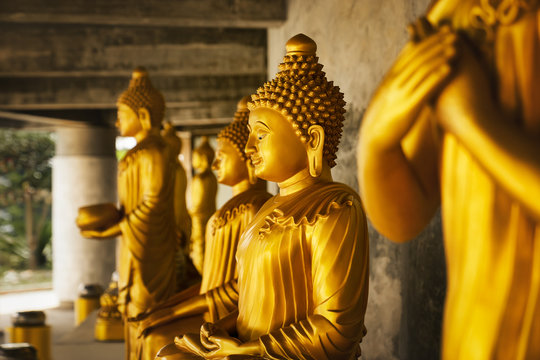 golden statue of a buddhist monk - close-up of praying holy spiritual statue with copy space