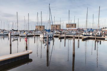 Muiderzand marina. Sailing yachts in evening