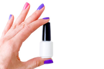 Beauty, fashion and Nail art concept. Woman hand with colorful manicure pink and purple colors close-up with white bottle of gel nail polish. isolated on white background. mock up. copy space