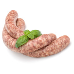 Raw sausage with basil leaf isolated on white background