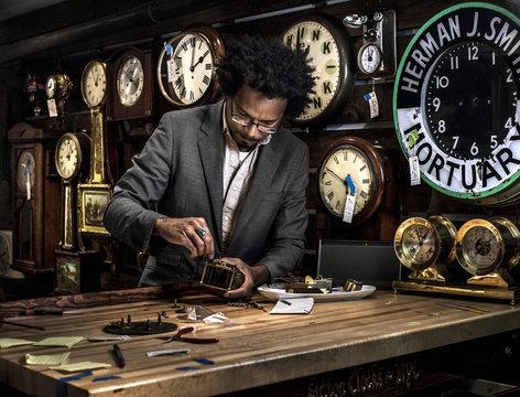 Clockmaker in his workshop