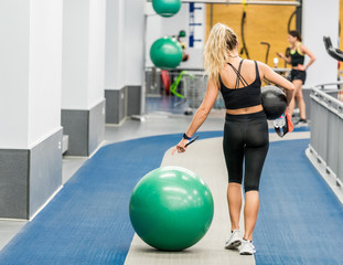 female athlete is carring workout materials